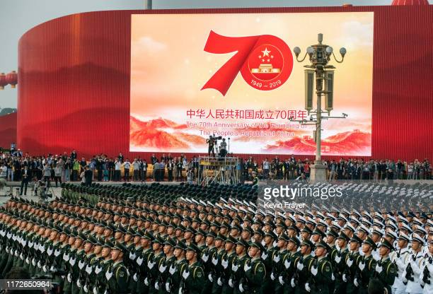Chinese military march in in formation as they do a last rehearsal before a parade to celebrate the 70th Anniversary of the founding of the People's...