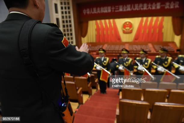 Chinese military musicians pose for a picture after the 5th plenary session of the first session of the 13th National People's Congress at the Great...