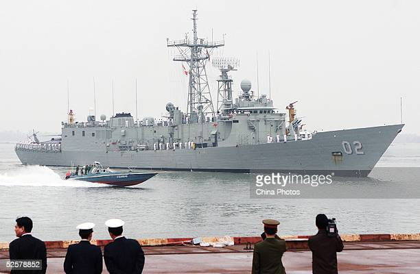 Chinese military officers welcome the frigate Canberra of the Royal Australian Navy after it arrived to port April 2, 2005 in Zhanjiang of Guangdong...