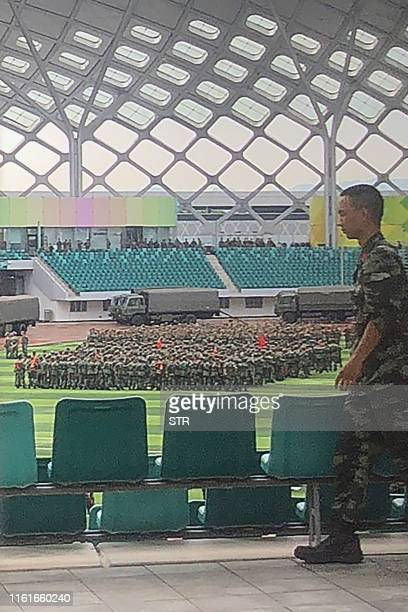 Chinese military personnel gather at the Shenzhen Bay stadium in Shenzhen bordering Hong Kong in China's southern Guangdong province on August 15...