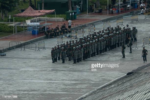 Chinese military personnel gather at the Shenzhen Bay stadium in Shenzhen bordering Hong Kong in China's southern Guangdong province on August 16...