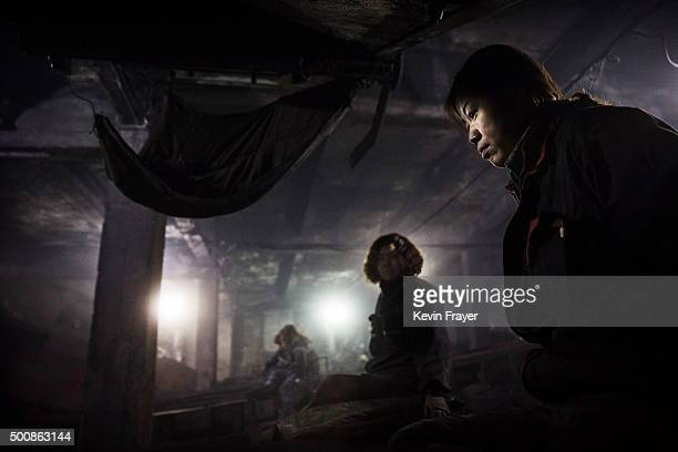 Chinese mine workers sort coal for quality at a mine on November 25 2015 in Shanxi China A history of heavy dependence on burning coal for energy has...