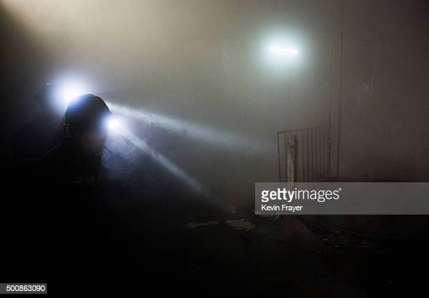 Chinese miners wear headlamps as they work at a coal mine on November 26 2015 in Shanxi China A history of heavy dependence on burning coal for...