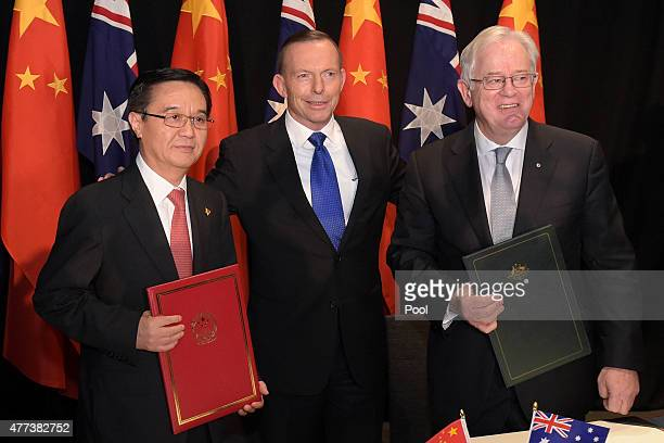 Chinese Minister of Commerce Dr Gao Hucheng Australian Prime Minister Tony Abbott and Australian Minister for Trade Andrew Robb pose for a photograph...