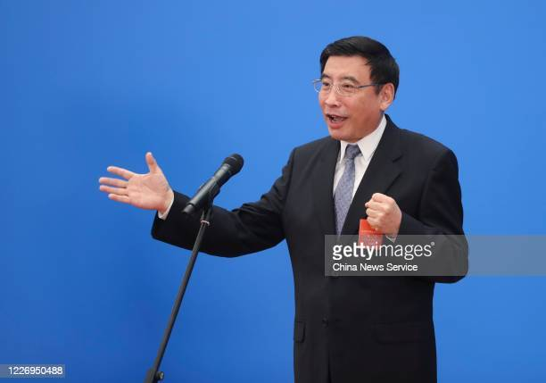 Chinese Minister of Industry and Information Technology Miao Wei, a deputy to the 13th National People's Congress , receives an interview via video...
