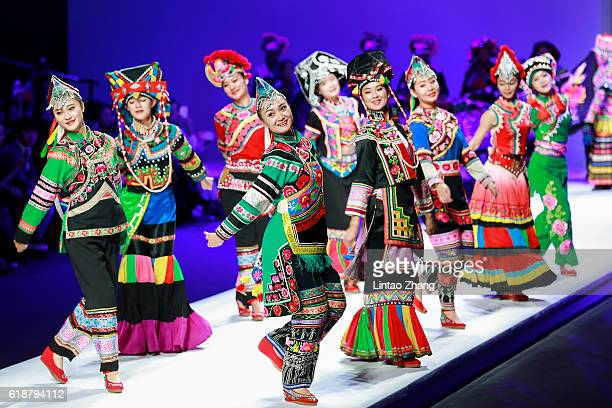 Chinese Minority performances during the Matyma series by Chinese designer Mary Ma during MercedesBenz China Fashion Week Spring/Summer 2017 at...