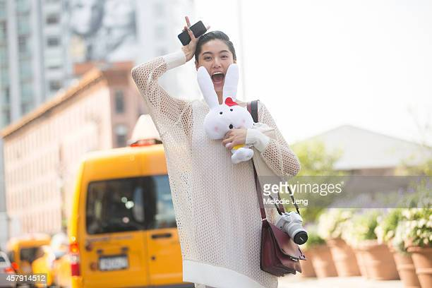 Chinese model Bonnie Chen exits the Peter Som show at Milk Studios in a Babyghost outfit and Nike sneakers on Day 3 of New York Fashion Week...