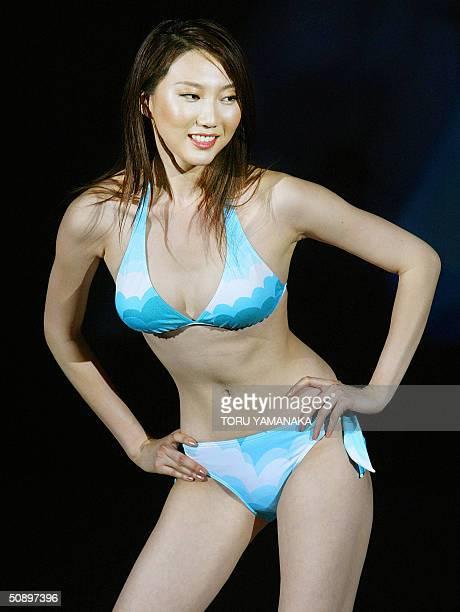 Chinese model Liuduo shows off bikini during the swimwear show of Japan's comprehensive chemical firm Asahi Kasei in Tokyo 26 May 2004 AFP PHOTO/Toru...