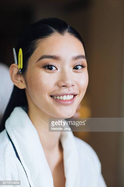 Chinese model Ming Xi prepares before the 2016 Manus x Machina Met Gala at the Mark Hotel on May 02 2016 in New York New York Manicure by Sheril...