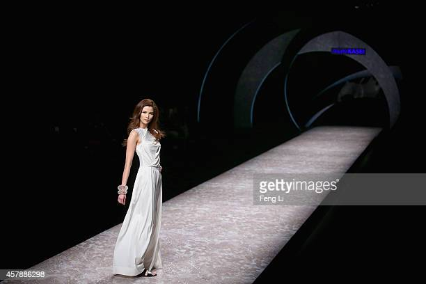 Chinese model Momo showcases designs on the runway at Asahi Kasei Chinese Fashion Designer Creativity Award - Hei Lau Collection show during...