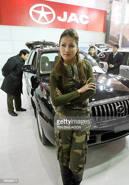 Chinese model promotes a domestic car during the Beijing Auto Show in Beijing, 09 December 2007. Sales of passenger vehicles in China, the world's...