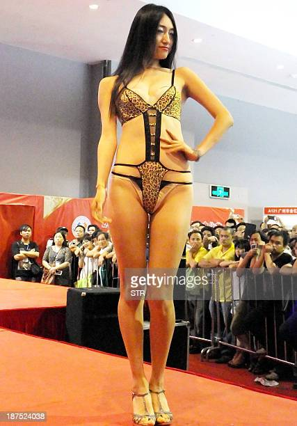 A Chinese model shows off a lingerie fashion at the Guangzhou Sex Culture Festival in Guangzhou south China's Guangdong province on November 10 2013...