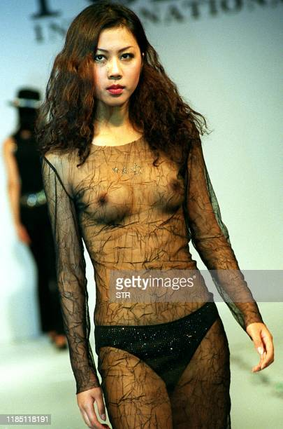 A Chinese model shows off seethrough colthing from 2001 Spring and Summer collection of Ports company with the manmade jewelry design of Austrian...
