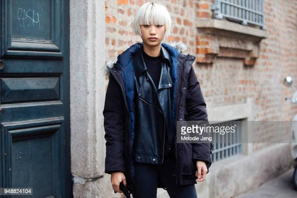 Chinese Model Xuan wears a black coat over a black leather jacket during Milan Fashion Week Fall/Winter 2018/19 on February 24 2018 in Milan Italy