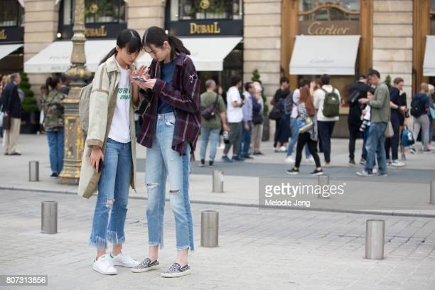 Chinese models Chunjie Liu Siqi Chen outside the Schiaparelli show on July 3 2017 in Paris France