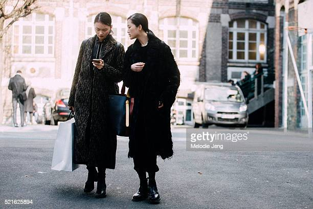 Chinese models Cong He and Jing Wen exit the John Galliano show at Lycee Carnot on Day 6 of PFW FW16 on March 06 2016 in Paris France Jing carries a...