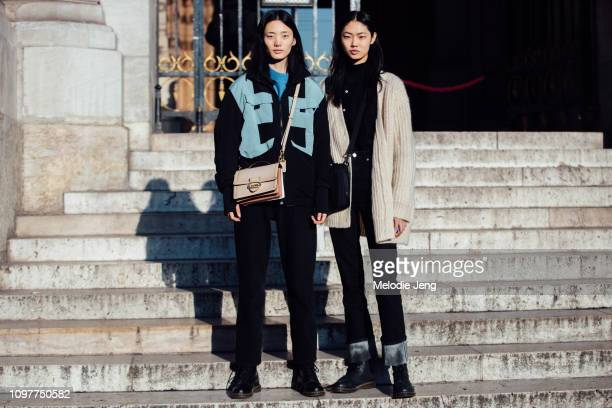 Chinese models Liu Han Sijia Kang after the Schiaparelli show during Couture SS19 Fashion Week on January 21 2019 in Paris France