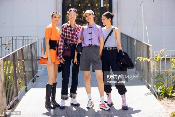 Chinese models Ning Jinyi, Sijia Kang, Wang Han, and Ruinan Dong after the Elie Saab show during Couture Fashion Week Fall/Winter 2019 on July 03,...