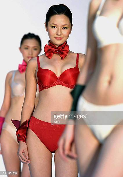 Chinese models show off a range of the latest undergarments launched by a local fashion house in Beijing 02 August 2004 The undergarment industry in...