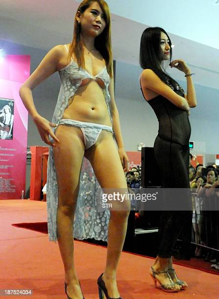 Chinese models show off lingerie fashions at the Guangzhou Sex Culture Festival in Guangzhou south China's Guangdong province on November 10 2013 The...