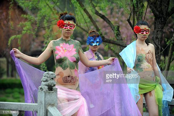 Chinese models show off their body paintings at a park in Ningguo east China's Anhui province on April 13 to attract tourists to the city China has...