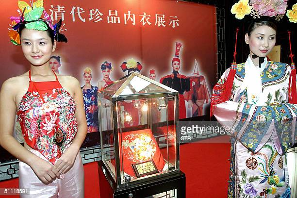 Chinese models show off what women wear underneath in the imperial Qing Dynasty era at a lingerie show in Beijing 27 July 2004 The Chinese fashion...