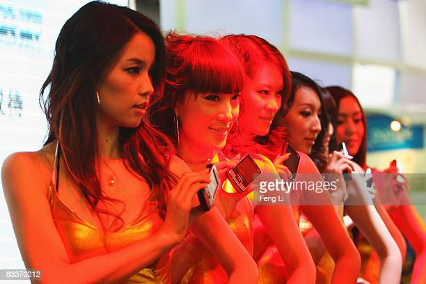 Chinese models show the new types of Coolpad mobile phones at the PT/Expo Communication China 2008 at China International Exhibition Center on...