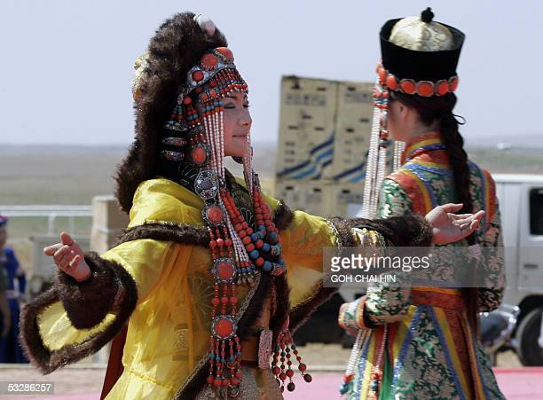 Chinese Mongolian models parade the latest in traditional fashion designed by a Mongolian designer during the Naadam festival on the grassland of...