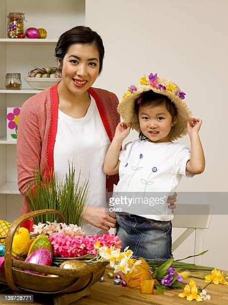 Chinese mother and child with Easter bonnet