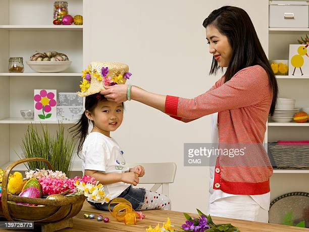 chinese mother and child with easter bonnet - easter bonnet stock pictures, royalty-free photos & images