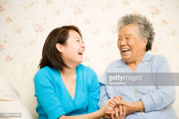 chinese mother and daughter laughing - generation gap stock pictures, royalty-free photos & images