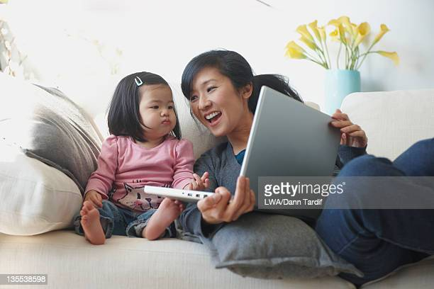 Chinese mother and daughter using laptop together