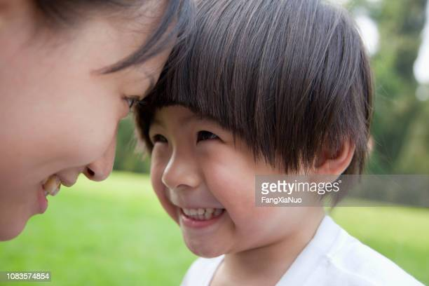 chinese mother and son smiling - morality stock photos and pictures