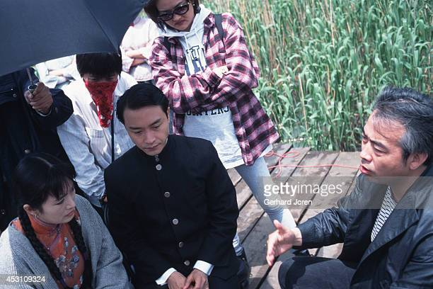 Chinese movie actress Gong Li with Hong Kong actor Leslie Cheung Kwok Wing with director Chen Kaige during the filming of 'Temptress Moon'