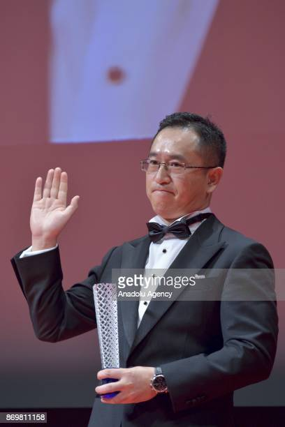 Chinese movie director Dong Yue winner the Award for Best Artistic Contribution for the movie 'The Looming Storm' during the closing ceremony of the...