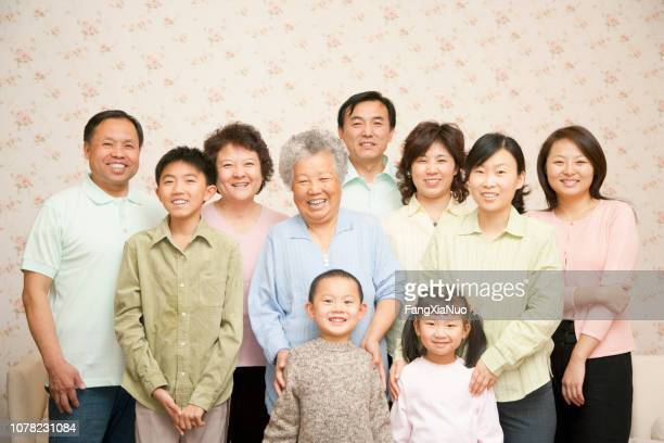 chinese multigenerational family portrait at home - large family stock pictures, royalty-free photos & images