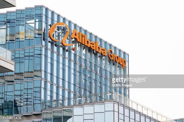 Chinese multinational e-commerce, retail, Internet, and technology conglomerate holding company Alibaba Group logo seen on top of a skyscraper.