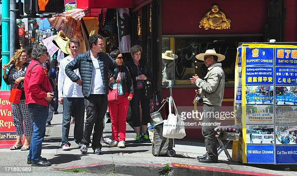 Chinese musician plays an erhu a Chinese string instrument for tips on a street corner in the Chinatown section of San Francisco The city's Chinatown...