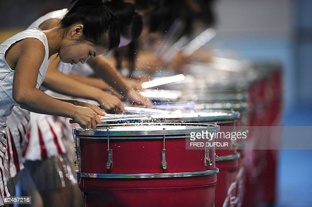 Chinese musicians play the drums during a women's water polo match of the 2008 Beijing Olympics Games on August 19 2008 AFP PHOTO / FRED DUFOUR