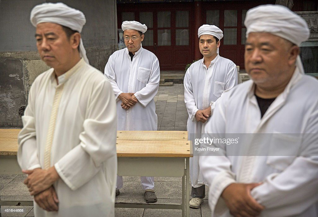 Chinese Muslim Imams of the Hui ethnic minority pray before breaking fast during the holy fasting month of Ramadan at the historic Niujie Mosque on July 3, 2014 in Beijing, China. The Hui Muslim community, which numbers more than an estimated 10 million throughout the country, is predominantly Chinese-speaking. Muslims around the world are marking Ramadan, where the devout fast from dawn until dusk, and is a time of fasting, prayer and charitable giving.
