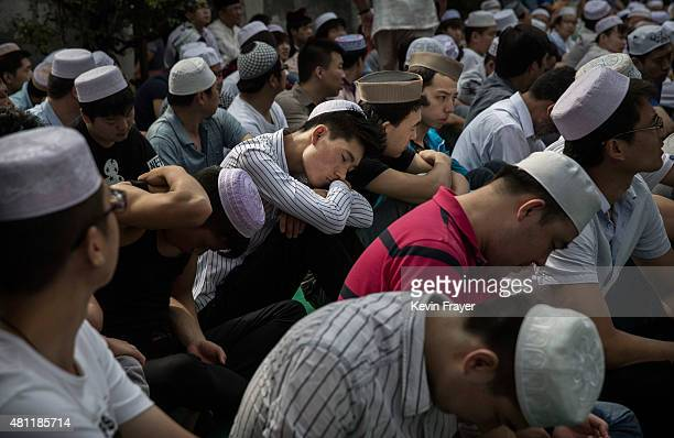 A Chinese Muslim of the Hui ethnic minority naps before Eid Al Fitr prayers marking the end of the holy fasting month of Ramadan at the historic...