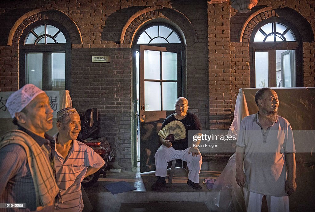 Chinese Muslims of the Hui ethnic minority chat after breaking fast during the holy fasting month of Ramadan at the historic Niujie Mosque on July 3, 2014 in Beijing, China. The Hui Muslim community, which numbers more than an estimated 10 million throughout the country, is predominantly Chinese-speaking. Muslims around the world are marking Ramadan, where the devout fast from dawn until dusk, and is a time of fasting, prayer and charitable giving.