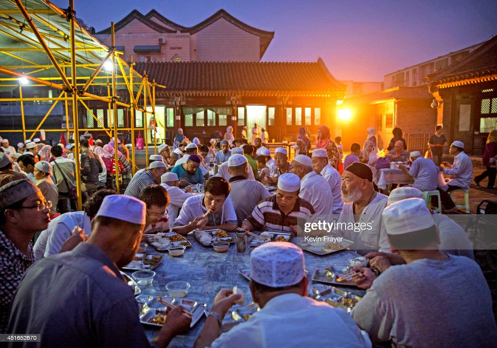Chinese Muslims of the Hui ethnic minority eat as they break fast during the holy fasting month of Ramadan at the historic Niujie Mosque on July 3, 2014 in Beijing, China. The Hui Muslim community, which numbers more than an estimated 10 million throughout the country, is predominantly Chinese-speaking. Muslims around the world are marking Ramadan, where the devout fast from dawn until dusk, and is a time of fasting, prayer and charitable giving.