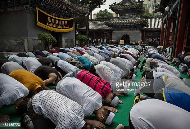 Chinese Muslims of the Hui ethnic minority pray during Eid Al Fitr prayers marking the end of the holy fasting month of Ramadan at the historic...