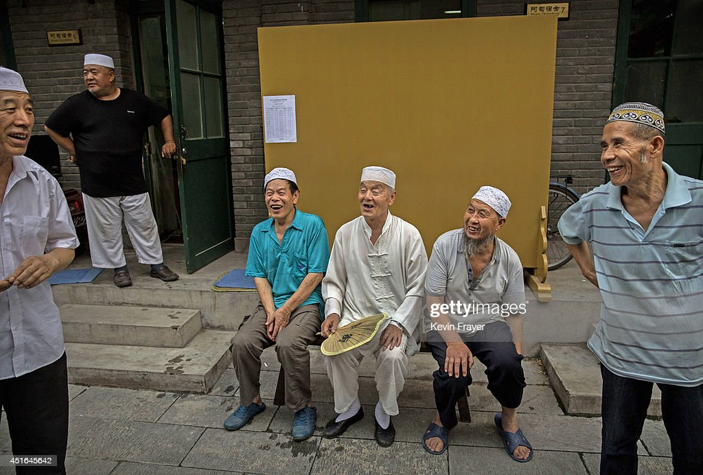 Chinese Muslims of the Hui ethnic minority wait to break fast during the holy fasting month of Ramadan at the historic Niujie Mosque on July 3, 2014 in Beijing, China. The Hui Muslim community, which numbers more than an estimated 10 million throughout the country, is predominantly Chinese-speaking. Muslims around the world are marking Ramadan, where the devout fast from dawn until dusk, and is a time of fasting, prayer and charitable giving.