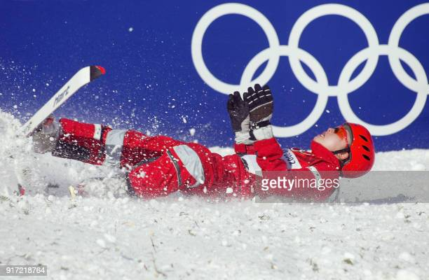 Chinese Nannan Xu falls after performing her jump during the Women's Aerials final for the Winter Olympics 18 February 2002 at Deer Valley Resort AFP...
