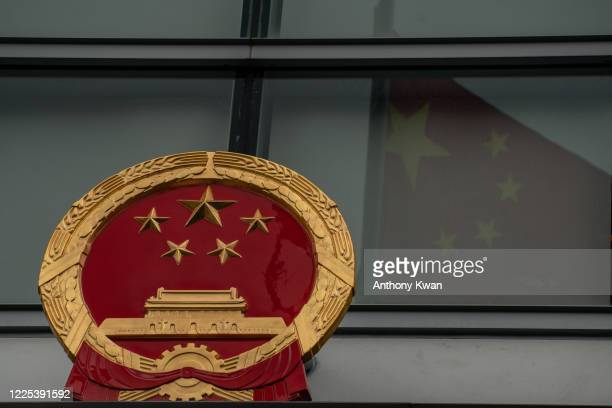 Chinese national emblem and flag is seen outside the Office for Safeguarding National Security of the Central People's Government in the Hong Kong...