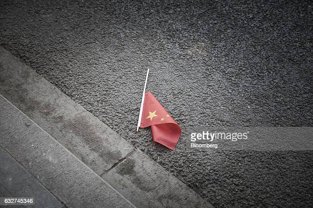 A Chinese national flag lies on the ground inside the Palace Museum at the Forbidden City in Beijing China on Thursday Nov 24 2016 Beijings Palace...