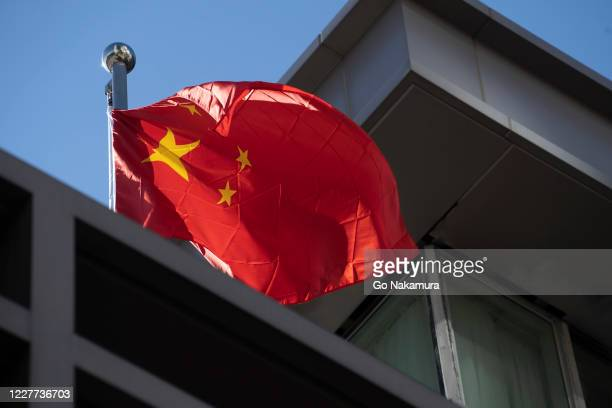 Chinese national flag waves at the Chinese consulate after the United States ordered China to close its doors on July 22, 2020 in Houston, Texas....