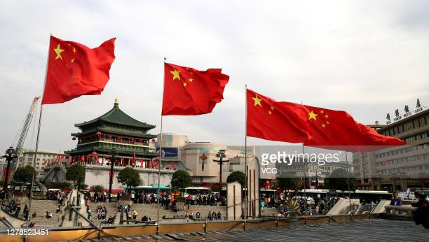 Chinese national flags flutter on the street on the fourth day of the National Day and Mid-Autumn Festival holiday on October 4, 2020 in Xi'an,...